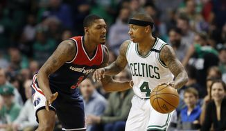 Washington Wizards' Bradley Beal (3) defends against Boston Celtics' Isaiah Thomas (4) during the fourth quarter of a second-round NBA playoff series basketball game, Sunday, April, 30, 2017, in Boston. The Celtics won 123-111. (AP Photo/Michael Dwyer) **FILE**