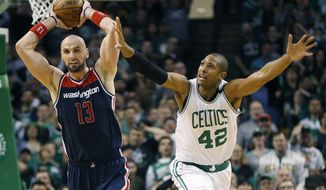Washington Wizards' Marcin Gortat (13) looks pass in front of Boston Celtics' Al Horford (42) during the third quarter of a second-round NBA playoff series basketball game, Sunday, April, 30, 2017, in Boston. The Celtics won 123-111. (AP Photo/Michael Dwyer)