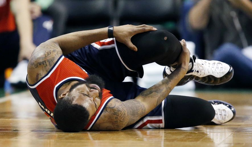 Washington Wizards' Markieff Morris holds his leg during the second quarter of a second-round NBA playoff series basketball game against the Boston Celtics, Sunday, April, 30, 2017, in Boston. (AP Photo/Michael Dwyer)
