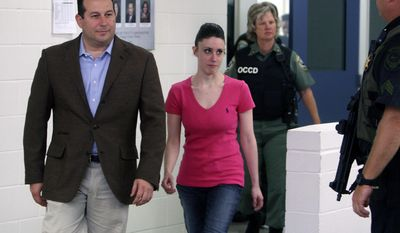 FILE - In this July 17, 2011, file photo, Casey Anthony, center, walks out of the Orange County Jail with her attorney Jose Baez, left, upon her release in Orlando, Fla. Baez won an acquittal for Anthony in the death of her daughter, and for former New England Patriots tight end Aaron Hernandez in his 2017 double-murder trial. Baez said he feels driven to defend people accused of crimes because he believes they are sometimes treated harshly by the system and deserve a chance. (Red Huber/Orlando Sentinel via AP, Pool, File)