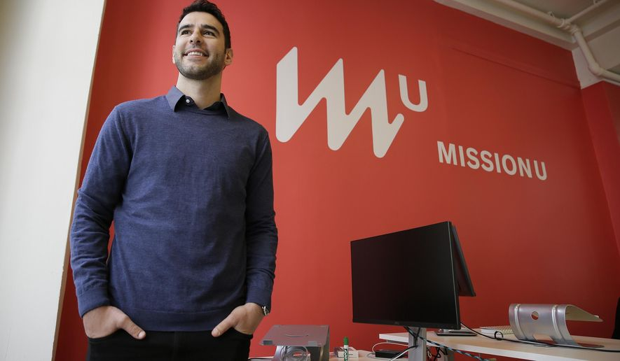 In this photo taken April 27, 2017, founder Adam Braun poses at MissionU in San Francisco. MissionU, which began accepting its first applications last month, offers a one-year program in data analytics and business intelligence with an upfront tuition of $0. As part of a profit-sharing agreement, MissionU students will be giving back 15 percent of their salary for three years after graduation, given that they make at least $50,000 per year. (AP Photo/Eric Risberg)