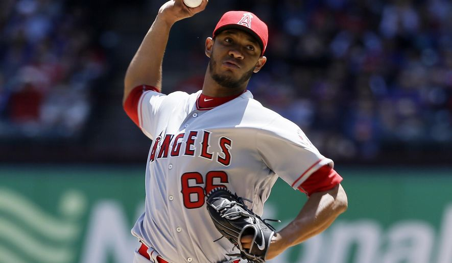 Los Angeles Angels starting pitcher JC Ramirez throws to the Texas Rangers in the first inning of a baseball game in Arlington, Texas, Sunday, April 30, 2017. (AP Photo/Tony Gutierrez)