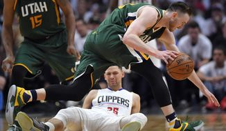Utah Jazz forward Gordon Hayward, top, knocks over Los Angeles Clippers guard Austin Rivers during the second half in Game 7 of an NBA basketball first-round playoff series, Sunday, April 30, 2017, in Los Angeles. Rivers was charged with a foul on the play. (AP Photo/Mark J. Terrill)