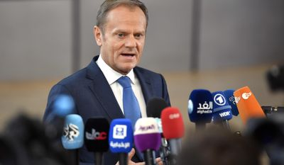 European Council President Donald Tusk speaks with the media as he arrives for an EU summit at the Europa building in Brussels on Saturday, April 29, 2017. EU Council President Donald Tusk says that Britain will face a united bloc of 27 EU nations in the two years of divorce negotiations and said the welfare of citizens and families living in each other's nations will be the priority once the talks start. (AP Photo/Martin Meissner)