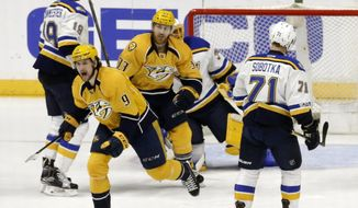 Nashville Predators left wing Filip Forsberg (9), of Sweden, and left wing Colin Wilson (33) celebrate after Ryan Ellis (not shown) scored against the St. Louis Blues during the first period in Game 3 of a second-round NHL hockey playoff series Sunday, April 30, 2017, in Nashville, Tenn. (AP Photo/Mark Humphrey)