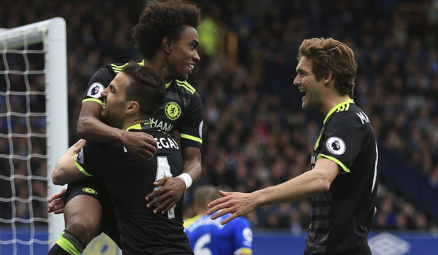 Chelsea's Willian, top left, celebrates scoring his side's third goal of the game during their English Premier League soccer match against Everton at Goodison Park, Liverpool, England, Sunday, April 30, 2017. (Nigel French/PA via AP)