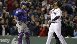 Boston Red Sox's Hanley Ramirez, right, looks up as he arrives at home plate to score on his two-run home run as Chicago Cubs catcher Willson Contreras, left, looks on in the first inning of a baseball game, Sunday, April 30, 2017, in Boston. (AP Photo/Steven Senne)