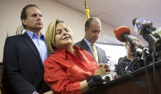 In this Wednesday, Aug. 12, 2015, file photo, U.S. Rep. Ileana Ros-Lehtinen, R-Fla., center, listens to a question from the media as she is joined by U.S. Rep. Mario Diaz-Balart, R-Fla., right, and his brother, former Congressman Lincoln Diaz-Balart, during a news conference, in Miami. Ros-Lehtinen of Florida, the first Cuban-American elected to Congress, is retiring at the end of her term next year, saying it's time to move on after 38 years in office. The Miami Herald first reported the retirement Sunday, April 30, 2017. (AP Photo/Wilfredo Lee, File)