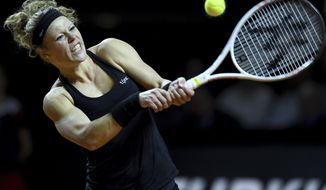 Germany's Laura Siegemund returns the ball to Kristina Mladenovic of France during the final match of the Porsche tennis Grand Prix in Stuttgart, Germany, Sunday, April 30, 2017. (Bernd Weissbrod/dpa via AP)