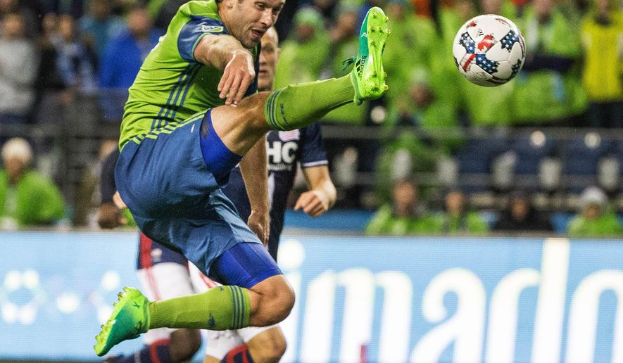 Seattle Sounders' Will Bruin gets off a shot against the New England Revolution during the closing minutes of an MLS soccer match Saturday, April 29, 2017, in Seattle. (Dean Rutz/The Seattle Times via AP)