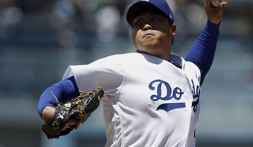 Los Angeles Dodgers starting pitcher Hyun-Jin Ryu throws to the plate against the Philadelphia Phillies during the first inning of a baseball game in Los Angeles, Sunday, April 30, 2017. (AP Photo/Alex Gallardo)