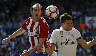 FILE - In this Saturday, April 8, 2017 file photo, Atletico Madrid's Diego Godin, left, goes for a header with Real Madrid's Pepe during the La Liga soccer match between Real Madrid and Atletico Madrid at the Santiago Bernabeu stadium in Madrid. The Champions League semifinals begin this week with Spanish rivals Real Madrid and Atletico Madrid meeting for the fourth consecutive time in the European competition, while surprising French club Monaco will try to keep Italian champion Juventus from returning to the final for the second time in three seasons. (AP Photo/Francisco Seco, File)