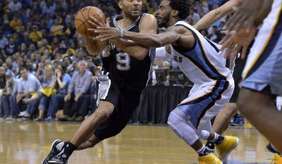 San Antonio Spurs guard Tony Parker (9) drives against Memphis Grizzlies guard Mike Conley during the second half of Game 6 in an NBA basketball first-round playoff series Thursday, April 27, 2017, in Memphis, Tenn. (AP Photo/Brandon Dill)