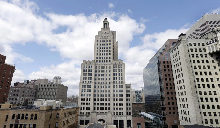 FILE - In this March 27, 2013, file photo the Bank of America Building, center, also known as the Superman building, stands among other buildings in downtown Providence, R.I. The current owner said Bank of America was dishonest about the building's condition when he bought it from them and a lawsuit over the building is now set to go to trial, as jury selection gets underway Tuesday, May 2, 2017. The Art Deco-style building became vacant amid the state's economic slump and is still empty years later. (AP Photo/Steven Senne, File)
