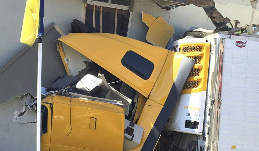 A large tractor-trailer crashed into an apartment building in Fullerton, Calif., Sunday, April 30, 2017 morning. Five apartments in the North Hills apartment complex on the 600 block of Imperial Highway were evacuated and deemed uninhabitable, Fullerton Police Sgt. Jon Radus said. The truck driver and a passenger were both hospitalized, he said. (Cindy Yamanaka/The Orange County Register via AP)