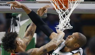 Boston Celtics' Al Horford, right, blocks a shot by Washington Wizards' Kelly Oubre Jr., left, during the second quarter of a second-round NBA playoff series basketball game, Sunday, April, 30, 2017, in Boston. (AP Photo/Michael Dwyer)