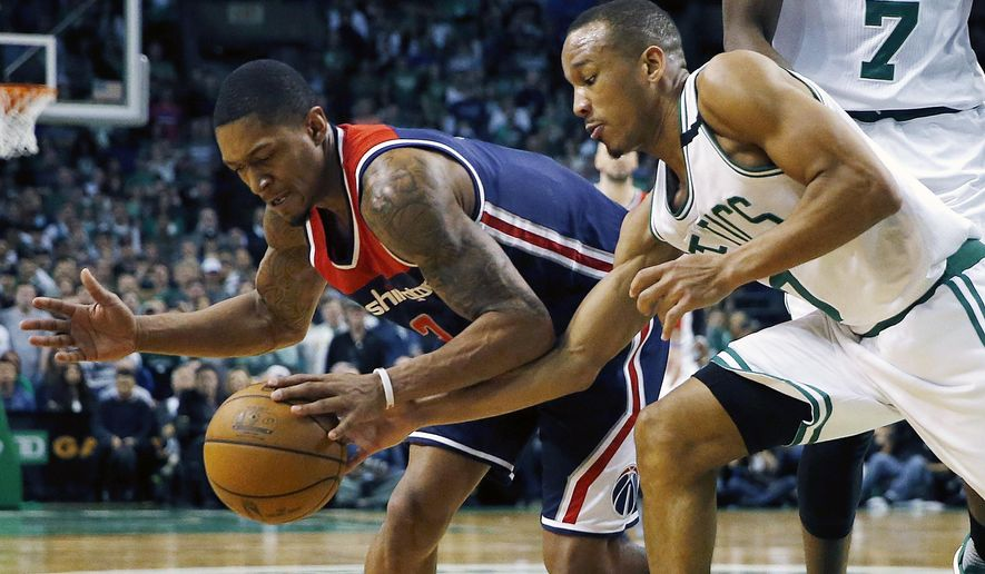Boston Celtics' Avery Bradley, right, knocks the ball away from Washington Wizards' Bradley Beal during the fourth quarter of a second-round NBA playoff series basketball game, Sunday, April, 30, 2017, in Boston. The Celtics won 123-111. (AP Photo/Michael Dwyer)