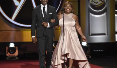 Blair Underwood, left, and Sherri Shepherd walk out on stage at the 44th annual Daytime Emmy Awards at the Pasadena Civic Center on Sunday, April 30, 2017, in Pasadena, Calif. (Photo by Chris Pizzello/Invision/AP)