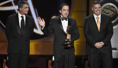 """Christopher Dunn, from left, Jeff Beldner, and Michael Montgomery accept the award for outstanding drama series writing team for """"The Young and the Restless"""" at the 44th annual Daytime Emmy Awards at the Pasadena Civic Center on Sunday, April 30, 2017, in Pasadena, Calif. (Photo by Chris Pizzello/Invision/AP)"""