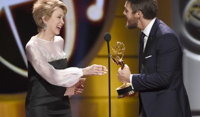 """Jane Pauley, left, presents the award for outstanding lead actor in a drama series to winner Scott Clifton for """"The Bold and the Beautiful"""" at the 44th annual Daytime Emmy Awards at the Pasadena Civic Center on Sunday, April 30, 2017, in Pasadena, Calif. (Photo by Chris Pizzello/Invision/AP)"""