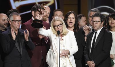 """Mary Connelly, center, accepts the award for outstanding entertainment talk show for """"The Ellen DeGeneres Show"""" at the 44th annual Daytime Emmy Awards at the Pasadena Civic Center on Sunday, April 30, 2017, in Pasadena, Calif. (Photo by Chris Pizzello/Invision/AP)"""