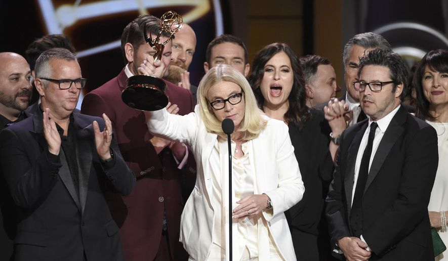 "Mary Connelly, center, accepts the award for outstanding entertainment talk show for ""The Ellen DeGeneres Show"" at the 44th annual Daytime Emmy Awards at the Pasadena Civic Center on Sunday, April 30, 2017, in Pasadena, Calif. (Photo by Chris Pizzello/Invision/AP)"