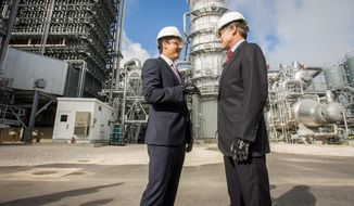 Energy Secretary Rick Perry (right) and NRG Energy CEO Mauricio Gutierrez toured the newly opened Petra Nova carbon capture and enhanced oil recovery system on April 13, 2017. This joint venture by NRG Energy and JX Nippon Oil & Gas Exploration Corp. is located near Houston and started operations at the end of 2016. The project has delivered more than 300,000 tons of carbon dioxide to the West Ranch oil field, owned by Petra Nova and Hilcorp Energy. The CO2 is injected into the oil reservoir to increase oil production in a process called Enhanced Oil Recovery. Image courtesy of NRG Energy/AP.