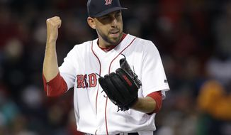 Boston Red Sox relief pitcher Matt Barnes celebrates as he steps off the mound after giving up no hits to the Chicago Cubs in the eighth inning of a baseball game, Sunday, April 30, 2017, in Boston. The Red Sox won 6-2. (AP Photo/Steven Senne)