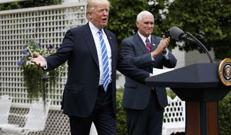 Vice President Mike Pence applauds as President Donald Trump arrives in the Kennedy Garden of the White House in Washington, Monday, May 1, 2017, to speak to the Independent Community Bankers Association. (AP Photo/Evan Vucci)