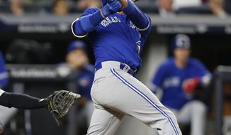 Toronto Blue Jays Ryan Goins hits a sacrifice fly in the sixth inning of a baseball game against the New York Yankees in New York, Monday, May 1, 2017. (AP Photo/Kathy Willens)