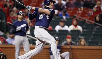 Milwaukee Brewers' Travis Shaw watches his three-run home run during the 10th inning of a baseball game against the St. Louis Cardinals, Monday, May 1, 2017, in St. Louis. (AP Photo/Jeff Roberson)