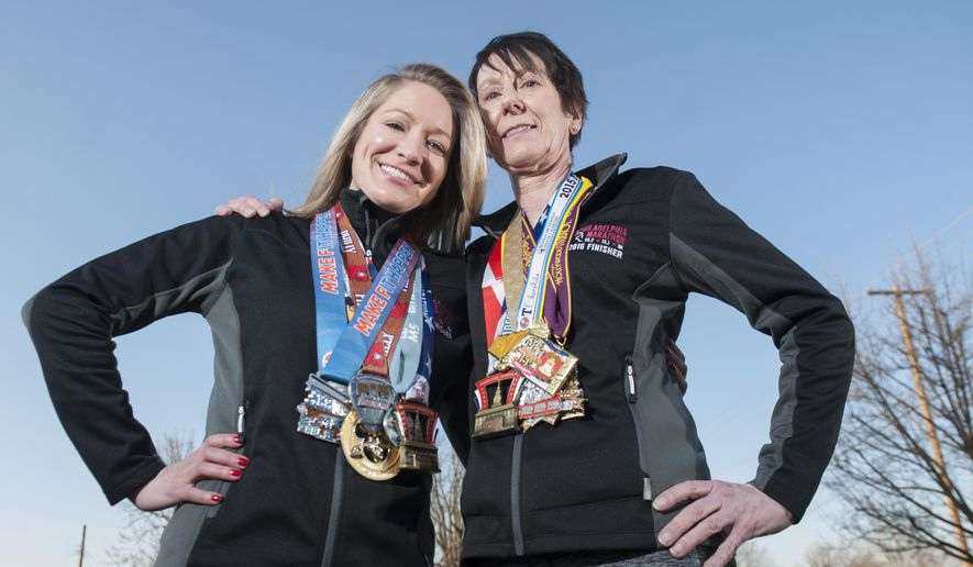 In a Feb. 6, 2017 photo, Cheryl DeLorenzo of Paulsboro, right, and her daughter Leann DeLorenzo, who resides in Philadelphia, pose for a photo in Paulsboro, N.J. The mother and daughter started running together years ago, when Leann was playing on her high school boys' soccer team and wanted her runner-mom to help her train. A few years ago, the two started running marathons together, and now they're training to enter their first triathlon.   (Chris LaChall/Camden Courier-Post via AP)