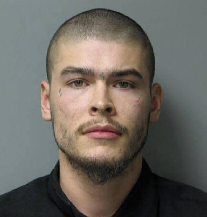 This photo released by the Howard County Police Department shows David M. Watson, who escaped from the custody of the Wicomico County Sheriff's Office at Clifton T. Perkins Hospital Center in Jessup, Md. Wicomico County Department of Corrections Director George Kaloroumakis said Friday, April 28, 2017,  Watson, an inmate from Delaware, was being taken to the hospital for an evaluation, but he escaped in the hospital's parking lot. Authorities are searching for him. (Howard County Police Department via AP)