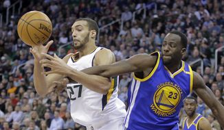 FILE - In this Dec. 8, 2016, file photo, Utah Jazz center Rudy Gobert (27) and Golden State Warriors forward Draymond Green (23) battle for a rebound in the second half during an NBA basketball game in Salt Lake City. Golden State and Utah begin their best-of-seven NBA second round playoff series on Tuesday, May 2. (AP Photo/Rick Bowmer, File)