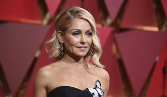 In this Feb. 26, 2017, file photo, Kelly Ripa arrives at the Oscars at the Dolby Theatre in Los Angeles. (Photo by Richard Shotwell/Invision/AP, File)