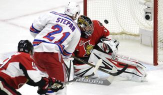 New York Rangers center Derek Stepan (21) scores on Ottawa Senators goalie Craig Anderson (41) as Senators' Derick Brassard (19) defends during the second period  in the second-round of the NHL hockey Stanley Cup playoffs, Saturday, April 29, 2017, in Ottawa. (Adrian Wyld/The Canadian Press via AP)