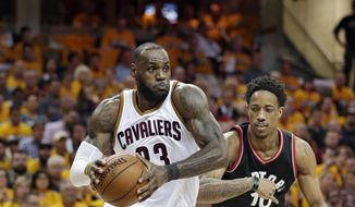 Cleveland Cavaliers' LeBron James (23) drives past Toronto Raptors' DeMar DeRozan (10) in the second half in Game 1 of a second-round NBA basketball playoff series, Monday, May 1, 2017, in Cleveland. The Cavaliers won 116-105. (AP Photo/Tony Dejak)