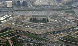 In this photo taken March 27, 2008, the Pentagon is seen in this aerial view. (AP Photo/Charles Dharapak)