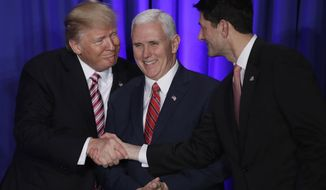 President Donald Trump, accompanied by Vice President Mike Pence, shakes hands with House Speaker Paul Ryan of Wis., before speaking at the Republican congressional retreat in Philadelphia, Jan. 26, 2017. (AP Photo/Matt Rourke) ** FILE **
