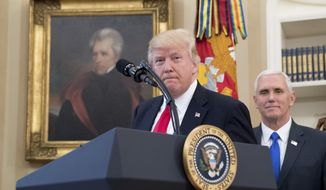 FILE - In this March 31, 2017 file photo, a portrait of former President Andrew Jackson hangs on the wall behind President Donald Trump, accompanied by Vice President Mike Pence, in the Oval Office at the White House in Washington. President Donald Trump made puzzling claims about Andrew Jackson and the Civil War in an interview, suggesting that he was uncertain about the origin of the conflict while claiming that Jackson was upset about the war that started more than a decade after his death.  (AP Photo/Andrew Harnik, File)
