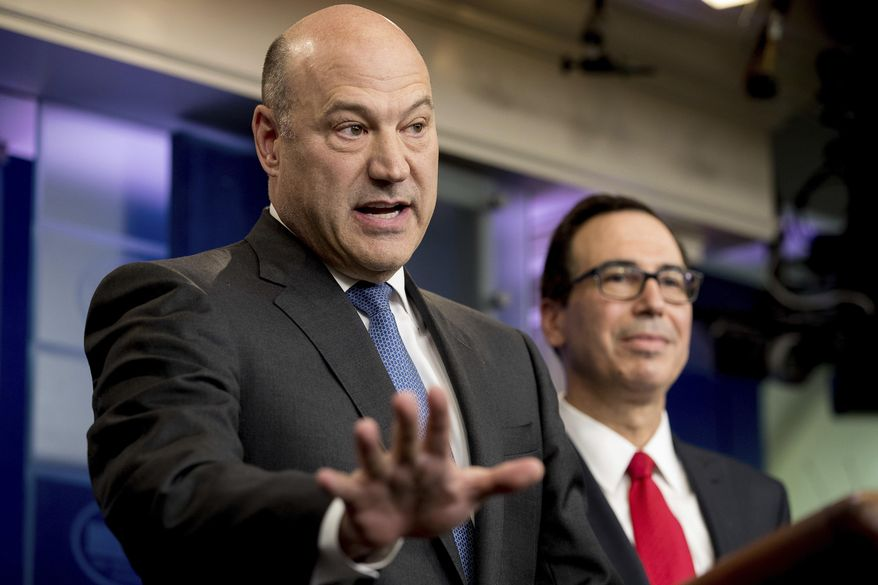 National Economic Director Gary Cohn, left, accompanied by Treasury Secretary Steve Mnuchin, speaks in the briefing room of the White House, in Washington, Wednesday, April 26, 2017, where they discussed President Donald Trump tax proposals. (AP Photo/Andrew Harnik) ** FILE **