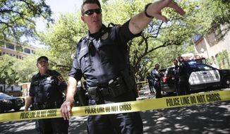 Law enforcement officers secure the scene after a fatal stabbing attack on the University of Texas campus Monday, May, 1, 2017. (Tamir Kalifa/Austin American-Statesman via AP)