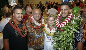 FILE - In this April 30, 2015, file photo, former Oregon quarterback Marcus Mariota, right, poses for a picture with his family at the Saint Louis Alumni Clubhouse on NFL Draft Day in Honolulu. His brother Matthew Mariota, left, Toa Mariota, his father, left center, and his mother Alana Deppe-Mariota, center right. Matt Mariota has an impressive mentor. As he navigates his career at Oregon, he's got older brother Marcus to consult. (Thomas Boyd/The Oregonian via AP, Pool, File)