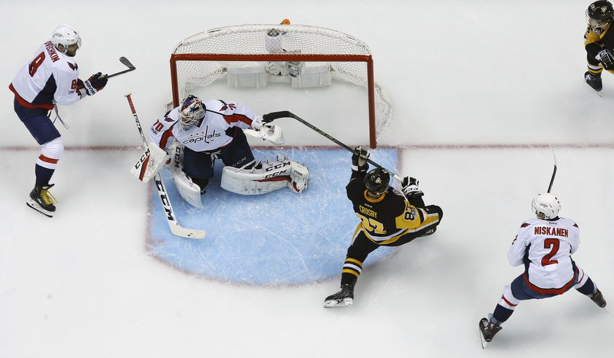 Pittsburgh Penguins' Sidney Crosby (87) is knocked off balance by Alex Ovechkin (8) before taking a hit from Washington Capitals' Matt Niskanen during the first period of Game 3 in an NHL Stanley Cup Eastern Conference semifinal hockey game against the Washington Capitals in Pittsburgh, Monday, May 1, 2017. Crosby left the game and did not return. The Capitals won in overtime 3-2. (AP Photo/Gene J. Puskar)