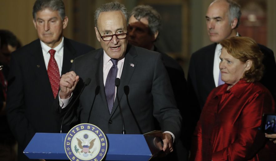 Senate Minority Leader Charles Schumer, D-N.Y., joined by, from left Sen. Joe Manchin, D-W.Va., Sen. Sherrod Brown, D-Ohio, Sen. Bob Casey, D-Pa., and Sen. Heidi Heitkamp, D-N.D., speaks during a news conference on Capitol Hill in Washington, Tuesday, May 2, 2017. (AP Photo/Carolyn Kaster)