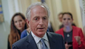 Sen. Bob Corker, R-Tenn., speaks to members of the media as he arrives for a policy luncheon with Vice President Mike Pence, Tuesday, May 2, 2017, on Capitol Hill in Washington. (AP Photo/Pablo Martinez Monsivais)