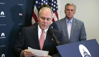 House Majority Whip Steve Scalise of La., accompanied by House Majority Leader Kevin McCarthy of Calif., reads a letter from a constituent concerning health care, Tuesday, May 2, 2017, on Capitol Hill in Washington following the Republican Caucus meeting. (AP Photo/Cliff Owen)