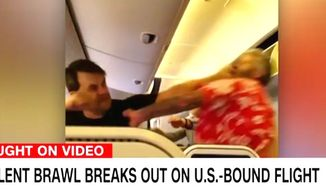 Two men brawl on a All Nippon Airways flight from Tokyo, Japan, to Los Angeles on May 1, 2017. (CNN screenshot via Twitter, Corey Hour)