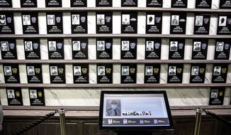 A new memorial wall and searchable computerized kiosk was unveiled Tuesday, May 2, 2017, inside the State Police Academy, which tells the stories of each of the 97 state police troopers who died in service to the state. On Pennsylvania State Police Day, the Pennsylvania State Police hold a public memorial ceremony, at the State Police Academy in Hershey, Pa., to honor the 97 members who gave their lives in the line of duty since the department was created on May 2, 1905.  (Dan Gleiter /PennLive.com via AP)