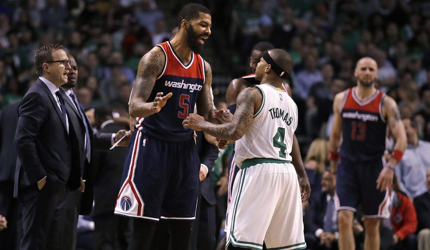 Boston Celtics guard Isaiah Thomas (4) and Washington Wizards forward Markieff Morris (5) exchange words during the second half of a second-round NBA playoff series basketball game in Boston, Tuesday, May 2, 2017. The Celtics defeated the Wizards 129-119 in overtime, taking a 2-0 lead in the series. (AP Photo/Charles Krupa)